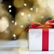 Christmas Present by sparkling tree